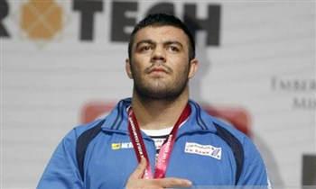 امیر علی اکبری، قهرمان کشتی ۲۰۱۳ جهان مادام العمر محروم شد
