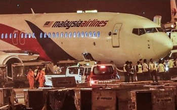 Malaysia Airlines jet in emergency landing after tyre bursts