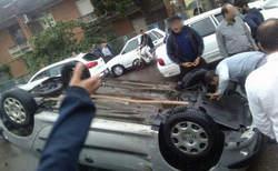 واژگونی پژو 206 در خیابان 22 آبان لاهیجان